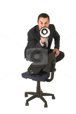 Businessman #246 stock photo, Businessman wearing a suit and a grey shirt.  Making a stunt on an office chair with a megaphone in his hand. by Sean Nel