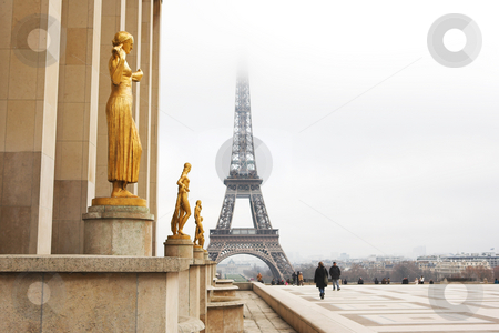 Paris #64 stock photo, A golden statue in the foreground with the Eiffel Tower in Paris, France.  Copy space. by Sean Nel