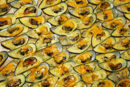 Mussels stock photo, Tray of mussels with cheese by Sean Nel
