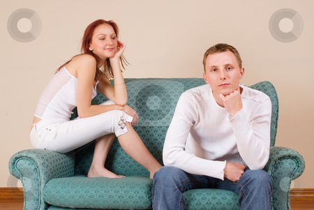 Trudy-Lee & Tommy #10 stock photo, Woman and boyfriend sitting on couch by Sean Nel