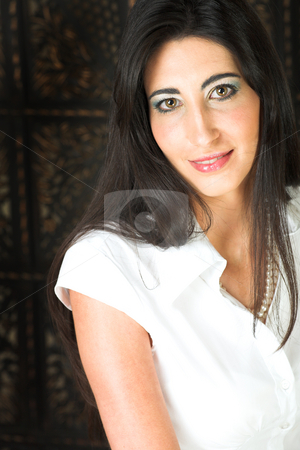 Beautiful young Italian woman stock photo, Beautiful young adult Italian businesswoman with long black hair, pearls and a white blouse by Sean Nel