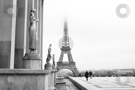 Paris #65 stock photo, A golden statue in the foreground with the Eiffel Tower in Paris, France. Black and white.   Copy space. by Sean Nel