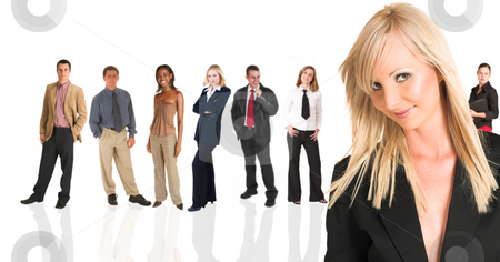 Blonde businesswoman standing in front of a business people grou stock photo, Beautiful blonde businesswoman standing in front of a group of business people all isolated on white. The whole group consists of multiracial young adults. The foreground is in sharp focus with the people in the background slightly blurred. by Sean Nel