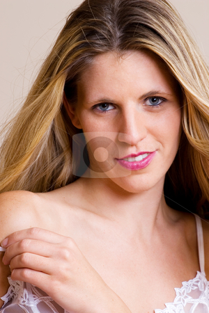 Lingerie #37 stock photo, Young blonde woman removing white lace lingerie by Sean Nel