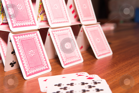 House of cards stock photo, House of cards on a wooden table (very shallow Depth of Field) by Sean Nel