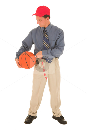 Coach #23 stock photo, Man in a red cap, standing with basket ball and whistle. by Sean Nel