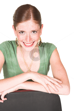 Caucasian businesswoman isolated on white stock photo, A tall smiling Caucasian businesswoman with brown trousers and a short sleeved green top and gold jewelry. Isolated on white is smiling at the viewer by Sean Nel