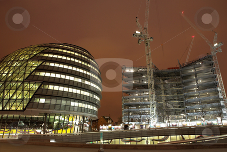 London #48 stock photo, Office block and construction scene at nighttime. by Sean Nel