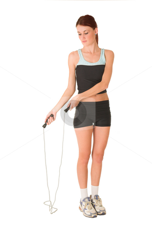 Gym #155 stock photo, Woman standing in gym wear with a skipping rope. by Sean Nel