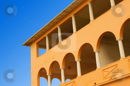Building #1 stock photo, Yellow coloured building with pilars and blue sky by Sean Nel