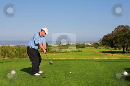 Golfer #64 stock photo, A golfer playing golf on a green.  Movement on the golf club. by Sean Nel