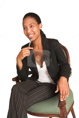 Mida Matsimela #6 stock photo, African business woman dressed in black jacket. Sitting on a chair, holding a pen, smiling by Sean Nel