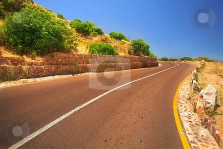 The Chapmanspeak road under a Blue sky stock photo, A winding road on Chapmans Peak, South Africa by Sean Nel