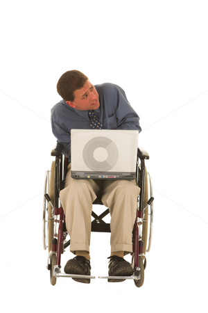 Businessman #129 stock photo, Man sitting in wheelchair working on a laptop. by Sean Nel