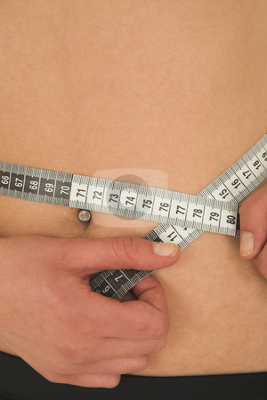 Gymbunny #38 stock photo, Woman with measuring tape by Sean Nel