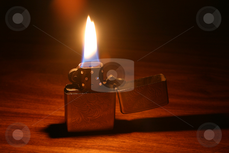Lit lighter stock photo, Open lighter with flame by Sean Nel
