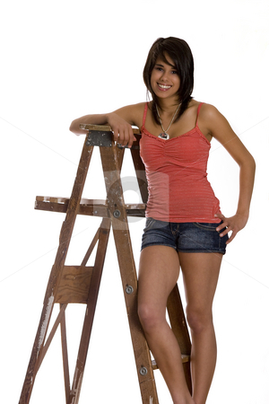 Teen on ladder stock photo, Teenage girl standing on ladder with a great big smile by Yann Poirier