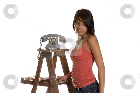 Teen and phone stock photo, Teenage girl standing on wood ladder with old rotary phone by Yann Poirier