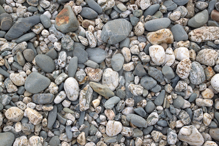 Lots of beach stones close up. stock photo, Lots of beach stones close up. by Stephen Rees