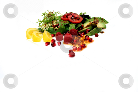 Salad On White stock photo, Salad ingredients isolated on a white background with red roma and yellow heirloom tomatoes, avocado slices, spinach leaf, pomegranate seeds, Raspberries topped with Olive oil and Raspberry vinaigrette dressing by Lynn Bendickson