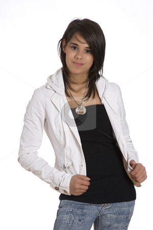 Teen with a shy smile stock photo, Portrait of a teenager girl against white background in fashion like pose with a shy smile by Yann Poirier