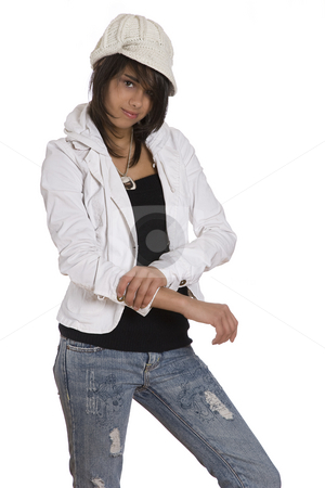 Pulling sleeve up stock photo, Teenage girl pulling up her sleeve wearing knitted hat and jeans with holes by Yann Poirier