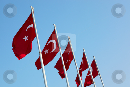 Red Turkish flags stock photo, Red turkish flags blowing in the wind on a clear blue sky day by Sean Nel