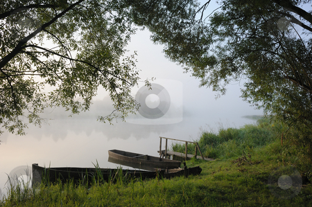 Boats in a morning fog stock photo, Sunrise, boats at coast in a morning fog. by Vladimir Blinov