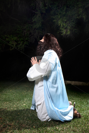 Prayer in times of trouble stock photo, Side view of Jesus in Garden of Gethsemane on knees praying to God. by Leah-Anne Thompson