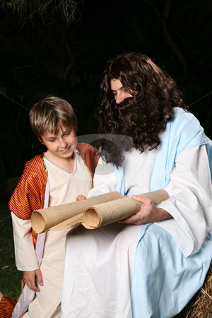 Religious man teaching the scriptures stock photo, Religious biblical man teaching to a child.   Could be Jesus, disciple or a prophet, eg Elijah. by Leah-Anne Thompson
