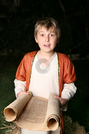 Boy reading a scroll stock photo, Boy reading from a gevil parchment scroll.  This one is written on goat skin. by Leah-Anne Thompson