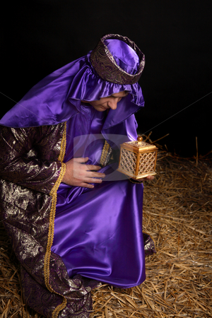 Wise man bowing and holding gift stock photo, Wiseman from the east, bowing on bended knee and holding a gift of golden box filled with fine frankincense resin. by Leah-Anne Thompson