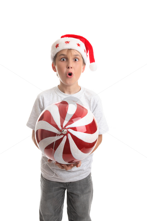 Christmas is here stock photo, Child holding a large Christmas bauble. by Leah-Anne Thompson