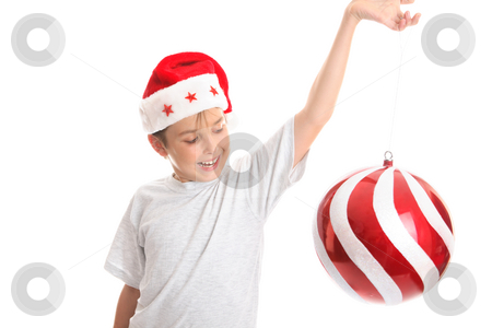 Child spinning large bauble stock photo, A child watches a large Christmas  bauble spin around with much delight.. by Leah-Anne Thompson