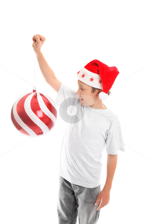 Get ready for Christmas stock photo, A child enjoying the Christmas season holdss up a big bauble by Leah-Anne Thompson