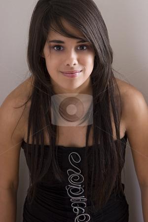 Teen in black dress stock photo, Teenager girl in little black dress leaning against a corner wall by Yann Poirier