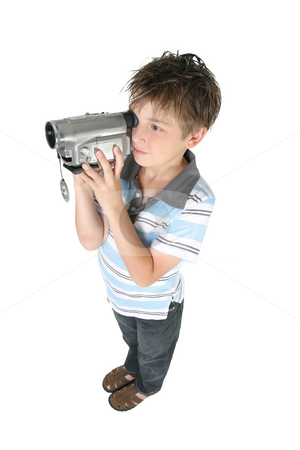 Standing boy using a digital video camera stock photo, Stamding boy filming with a digital video camera.   White background, by Leah-Anne Thompson