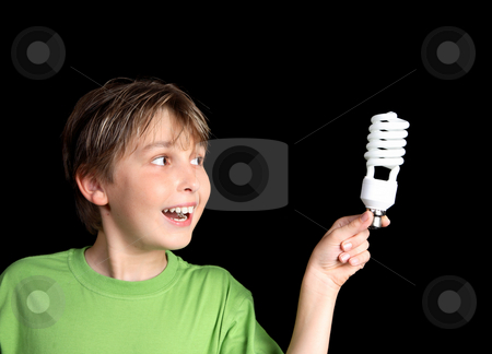 Green ideas for lighting stock photo, Horizontal closeup of a boy holding an energy efficient light globe and smiling inspirationally. by Leah-Anne Thompson