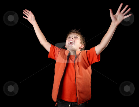 Enlightened Praise stock photo, A child raises his hands in praise by Leah-Anne Thompson