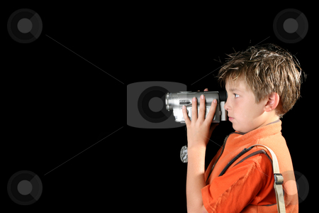 Home video camera stock photo, Boy filming using a home video camera,  camcorder. by Leah-Anne Thompson