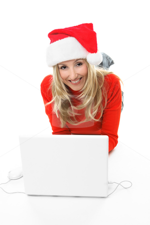 Christmas Shopping stock photo, A girl using a laptop computer is browsing the internet and shopping online for gifts.  She is looking up and smiling by Leah-Anne Thompson
