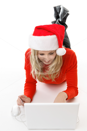 Christmas shopping online stock photo, A relaxed female shopping online for gifts by Leah-Anne Thompson