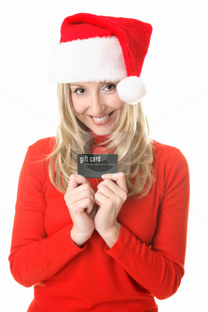 Christmas Shopping - Santa girl with a gift card stock photo, Girl wearing a festive  santa hat ready to spend some money, holding a gift card, store card or credit or debit card or other membership  or business card.  Insert your own card or replace my text with your own message. by Leah-Anne Thompson