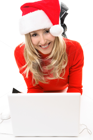 Christmas girl at laptop stock photo, Christmas girl on a laptop computer, shopping for gifts,  banking, etc online. by Leah-Anne Thompson