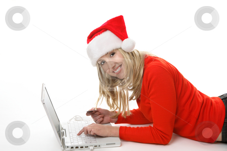 Christmas Shopping Online stock photo, A female using a laptop and shopping online buying  gifts at Christmastime. by Leah-Anne Thompson