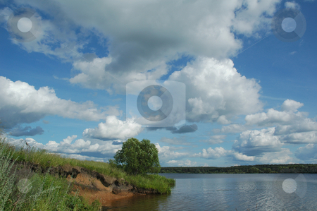 Greater river of Russia Volga stock photo, Greater river of Russia Volga in the afternoon under the blue sky with clouds by Olga Drozdova