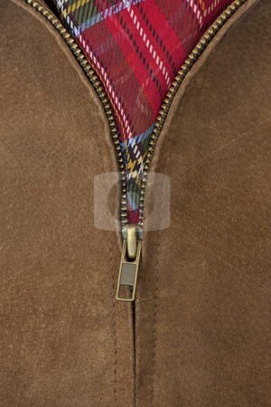 Unzipped brass zipper of leather jacket stock photo, Close-up of unzipped brass zipper of chamois leather jacket showing a red scarf by Marek Uliasz