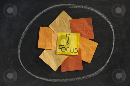 Focus concept on blackboard stock photo, Focus word with exclamation mark - yellow, orange, brown sticky notes  posted on blackboard by Marek Uliasz