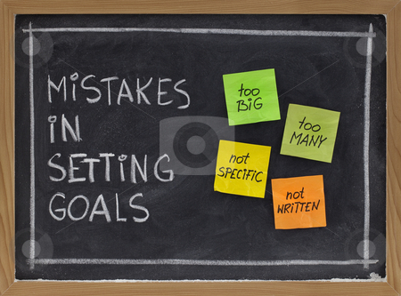Mistakes in setting goals stock photo, Common mistakes in setting goals (too many, too big, not specific, not written) - concept presented with sticky notes and white chalk handwriting on blackboard by Marek Uliasz