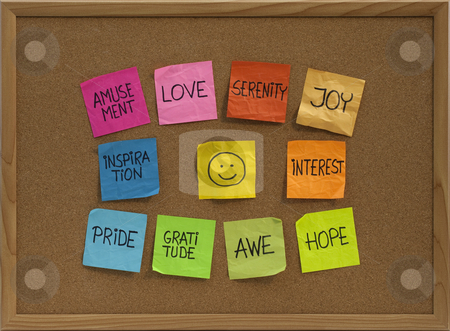 Smiley and ten positive emotions on bulletin board stock photo, Positive emotions concept - color sticky notes around smiley on cork bulletin board by Marek Uliasz